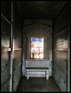 A lonely seat inside a mausoleum.