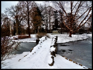 The snow covered foot bridge over Geyser Lake.