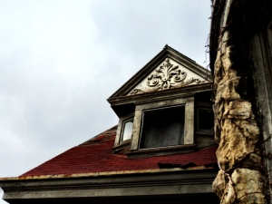 One of the dormers, decorated like delicate icing on a cake.